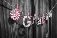 Grace. The word 'Grace' hanging on a string against a fence stock image