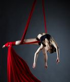 Graceful acrobat posing while doing trick Royalty Free Stock Photos