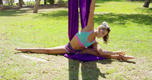 Graceful acrobatic dancer working out stock footage