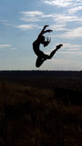 Graceful acrobatic woman leaping Royalty Free Stock Image