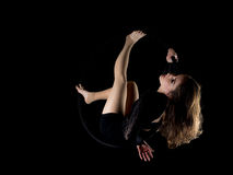 Graceful aerial dancer woman  on black Stock Images