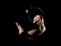 Graceful aerial dancer woman isolated on black Royalty Free Stock Photos