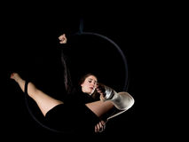 Graceful aerial dancer woman isolated on black Stock Images