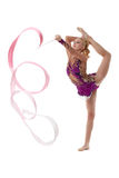 Graceful artistic gymnast performs with ribbon Royalty Free Stock Photo