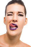 Graceful attractive woman with purple lips and nails Royalty Free Stock Images