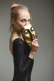 Graceful ballerina with a bronze metal mask Royalty Free Stock Photography