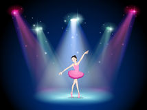 A graceful ballerina at the center of the stage Royalty Free Stock Photography