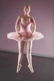 Graceful ballerina dancing en pointe Stock Photos