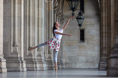 Graceful ballerina dancing in a palace royalty free stock image