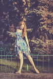 Graceful ballerina dancing in the park Royalty Free Stock Photography
