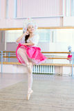 Graceful ballerina dancing in Russian costume Stock Photography