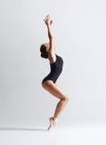 Graceful ballerina dancing in a studio. Graceful ballerina dancing in art performance. Young and beautiful ballet dancer Stock Images