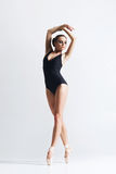 Graceful ballerina dancing in a studio Stock Photography