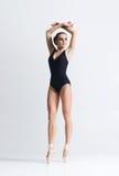 Graceful ballerina dancing in a studio Royalty Free Stock Photos