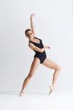 Graceful ballerina dancing in a studio Stock Photo