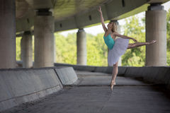 Graceful ballerina doing dance exercises on a Royalty Free Stock Photo