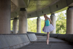 Graceful ballerina doing dance exercises on a Stock Photos