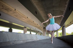 Graceful ballerina doing dance exercises on a Stock Photo