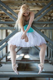 Graceful ballerina in the industrial background Stock Image