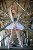 Graceful ballerina in the industrial background Royalty Free Stock Image