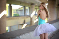 Graceful ballerina in the industrial background Stock Photos