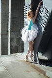 Graceful ballerina in the industrial background Royalty Free Stock Images