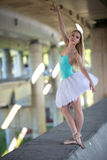 Graceful ballerina in the industrial background Stock Photo