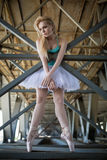 Graceful ballerina in the industrial background. Graceful ballerina in white tutu in the industrial background of the bridge Royalty Free Stock Image
