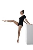 Graceful ballerina rehearses, isolated on white Royalty Free Stock Photo