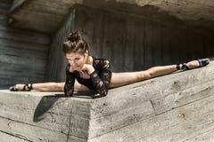 Graceful ballerina sitting in the cross splits Stock Images