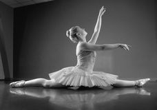 Graceful ballerina sitting with legs stretched out Stock Images