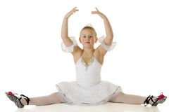 Graceful Ballerina Splits. An elemantary aged ballerina doing the splits gracefully in her dance costume.  On a white background Stock Photo