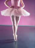 Graceful ballerina standing en pointe Royalty Free Stock Photo