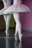 Graceful ballerina standing en pointe in front of mirror Stock Photo