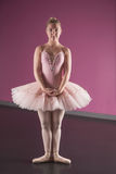 Graceful ballerina standing in first position Royalty Free Stock Photos