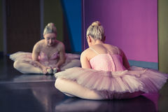 Graceful ballerina warming up in front of mirror Royalty Free Stock Images
