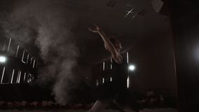 Graceful Ballerina In White Dress Dancing Elements Of Classical Or Modern Ballet In The Dark With. Graceful Ballerina In White Dress Dancing Elements Of stock footage
