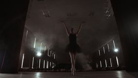 Graceful Ballerina In White Dress Dancing Elements Of Classical Or Modern Ballet In The Dark With. Graceful Ballerina In White Dress Dancing Elements Of stock video