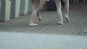 Graceful ballerinas goes away after performance stock video footage