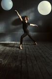 Graceful ballet dancer performing in the decorated studio Stock Photos