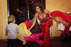 Graceful belly dancer with  fans Royalty Free Stock Photo