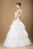 Graceful Bide in White Wedding Dress. Full Length Portrait of Graceful Bide in White Wedding Dress Stock Photo