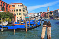 Graceful black gondolas wait for passengers Royalty Free Stock Image