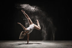 Graceful blonde dancing in white dust color Stock Photo