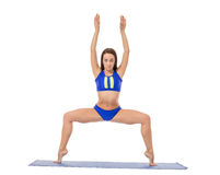 Graceful brunette doing yoga exercise Stock Photos