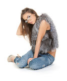 Graceful brunette in jeans and fur Royalty Free Stock Image