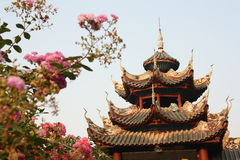 Graceful Chinese temple and flowers Stock Photo