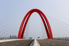 The graceful curve of red cable-stayed bridge Stock Images