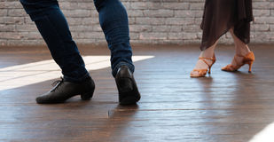 Graceful dance couple tangoing in the ballroom. Accomplishing every dance step together. Emotional skilled capable dance couple tangoing while having training Stock Image