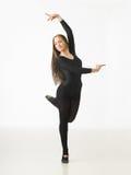 Graceful dancer. Beautiful female ballet dancer posing on white background Stock Photos